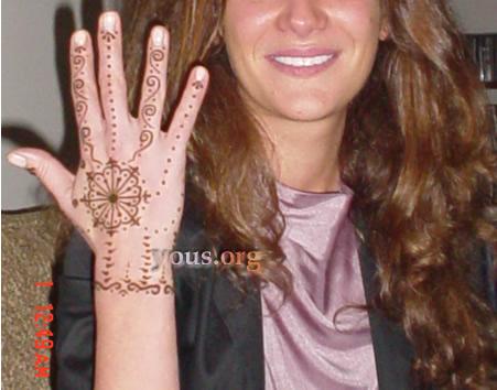 henna flower on hand
