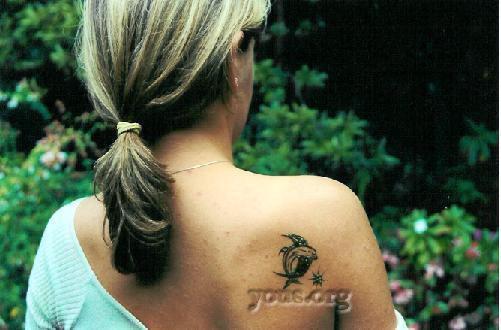 dolphin henna on shoulder